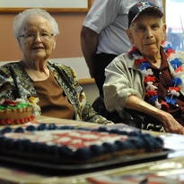 Lou E. Warshaw (left) feeds birthday cake to her husband, 102-year-old George Warshaw, on Friday. George Warshaw is a U.S. Army veteran who served from November 1942 to November 1945.