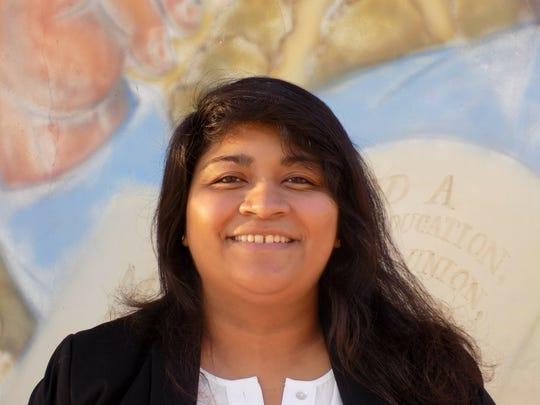 Genevieve Flores-Haro