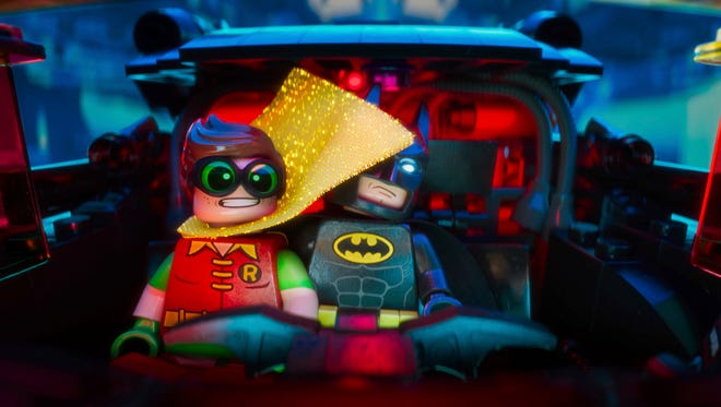 "Robin (left, voiced by Michael Cera) and Batman (voiced by Will Arnett) hit the road in ""The Lego Batman Movie."""