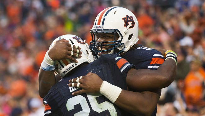 Auburn offensive lineman Avery Young celebrates with running back Peyton Barber (25) on Oct. 3, 2015.