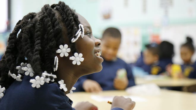 First grader Javia Johnson works on a lesson during class at St. Joseph Catholic School in the West End neighborhood of Cincinnati on Tuesday, Jan. 19, 2016. St. Joseph is currently implementing the blended learning method in its school, having students split time between traditional instruction and computer programs.