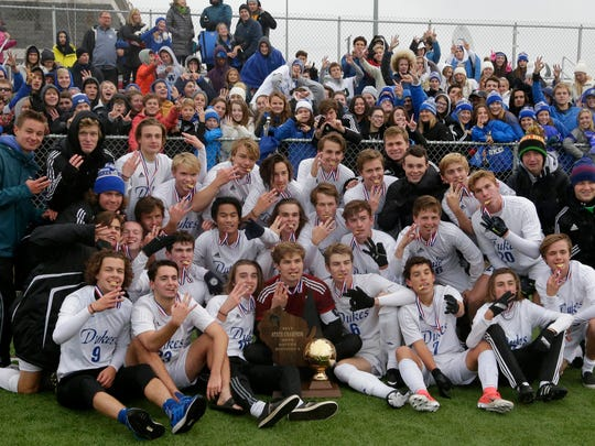 Whitefish Bay players pose with the golden soccer ball trophy after defeating Oregon, 6-1, in the WIAA Division 2 title match at Uihlein Soccer Park in Milwaukee.