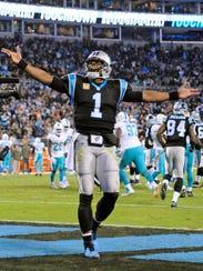 Carolina Panthers' Cam Newton (1) celebrates a touchdown