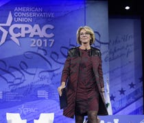 Betsy DeVos built her political resume raising and...