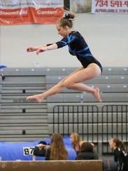 Jessica Weak of Livonia Blue perfoms on balance beam