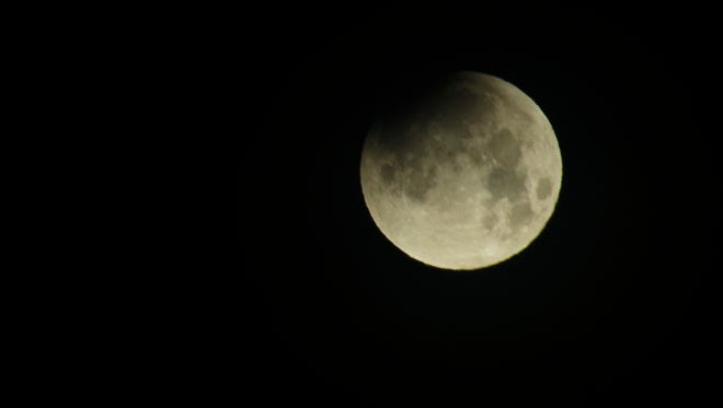 A partially eclipsed supermoon sets in Clarksville on January 31, 2018.