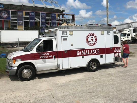 A special Alabama tailgate vehicle is outside of Camping