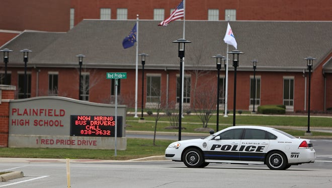 A Plainfield police car patrolled the perimeter of Plainfield High School on Dec. 17, 2015. The school was closed because of threats of violence on social media.