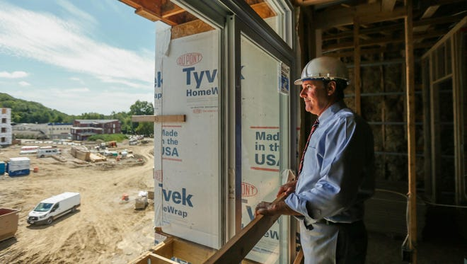 Jim Cohen, president of CMC, overlooks the process of commercial and residential buildings in downtown Loveland Wednesday.