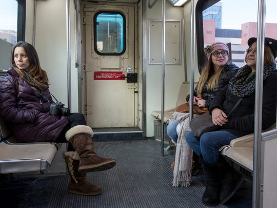 From left, Tiffanie Cobb, 26 of San Juan, Puerto Rico, her mother Glorianne Stewart, 46 of Rochester Hills and grandmother Carmen Rivera, 65 of San Juan are sightseeing from the People Mover in Detroit on Wednesday, December 20, 2017.