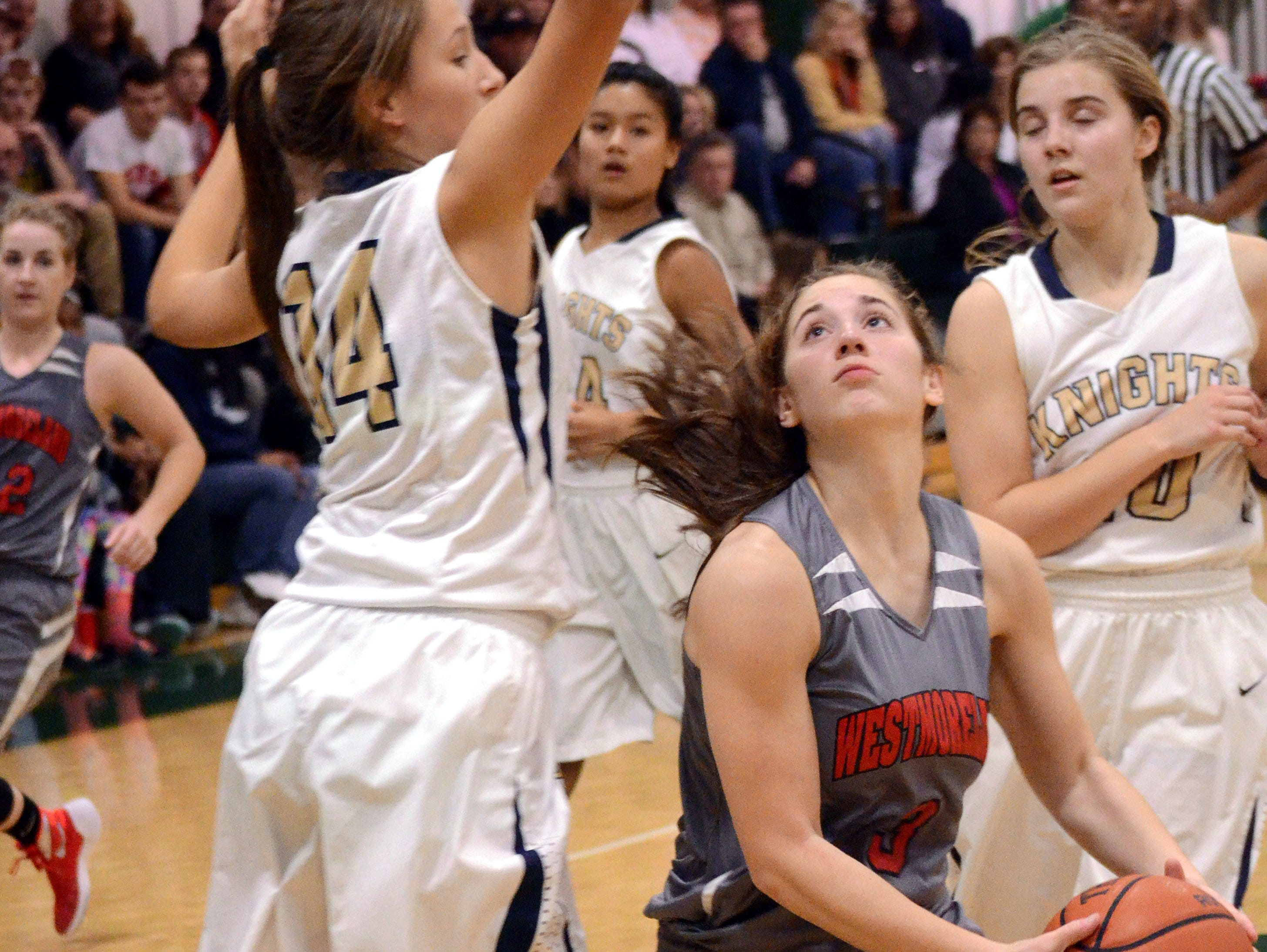Westmoreland High junior guard Gracie Oliver penetrates into the lane past Pope John Paul II sophomore Lindsey Semrow.