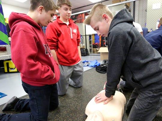 Theisen 8th graders Ben St. John, Kegan Olig and Sam