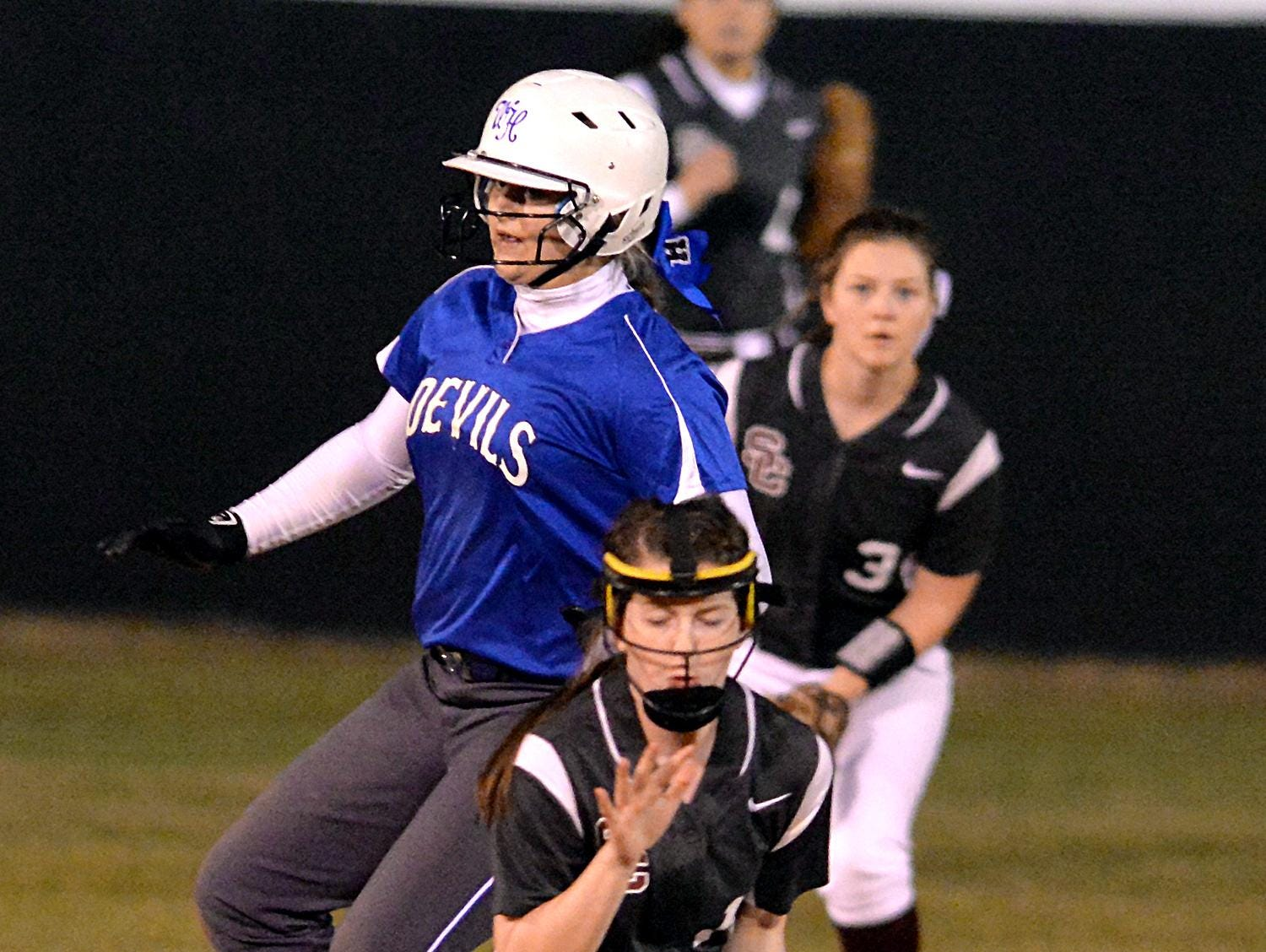 Station Camp freshman shortstop Addie Lange fields a low throw as White House junior Katy Gut reaches second base safely during Tuesday evening's jamboree.