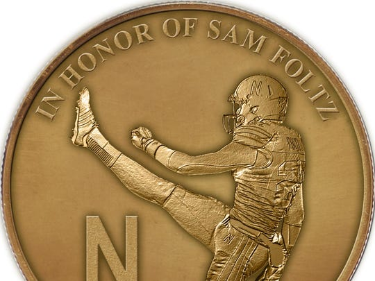 A coin commemorating former Michigan State punter Mike Sadler and Nebraska's Sam Foltz will be used this weekend for all seven of the Big Ten's conference games.