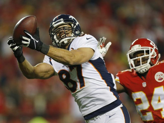 Denver Broncos wide receiver Eric Decker (87) makes a touchdown reception against Kansas City Chiefs cornerback Brandon Flowers (24) during the second half of an NFL football game,in Kansas City, Mo. NFL free agency begins Tuesday, March 11, 2014, with each team having another $10 million or so to spend thanks to the increased salary cap. Such standouts as receivers Eric Decker and Julian Edelman, defensive end Michael Bennett and cornerback Alterraun Verner figure to draw quick attention.