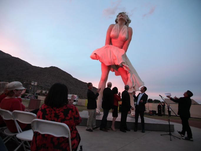 Red lights flood the Forever Marilyn statue in downtown Palm Springs Friday, January 31, 2014. The event is to promote the American Heart Association's Go Red for Women campaign and to kick off American Heart Month.  (Richard Lui The Desert Sun)