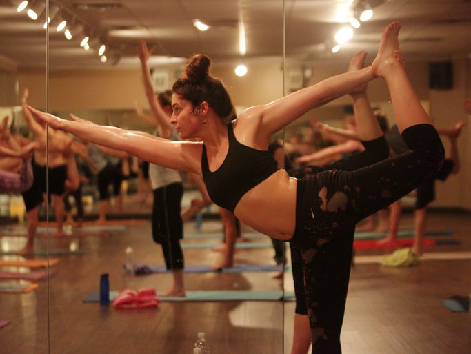 Ali Oldani holds a pose at Sumits Hot Yoga on Tuesday, April 15, 2014.