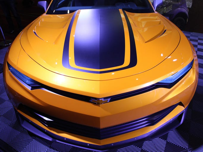 "The Chevy presentation at SEMA of its new cars for the movie ""Transformers: Age of Extinction."" included this updated ""Bumblebee"" Camaro, as well as a new C7 Corvette and a Sonic RS."