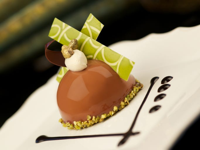 New desserts for Princess Cruises designed by chocolatier Norman Love include a chocolate pistachio dome with almond and pistachio nougatine.