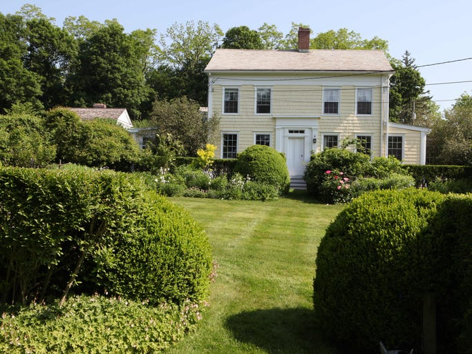 """The home and main garden of Page Dickey and her husband Francis """"Bosco"""" Schell for sale in North Salem, June 3, 2014. The 1830 farmhouse includes grounds that cover nearly 3 acres, with pool, husband/pool house, greenhouse, wildflower meadow and many gardens."""