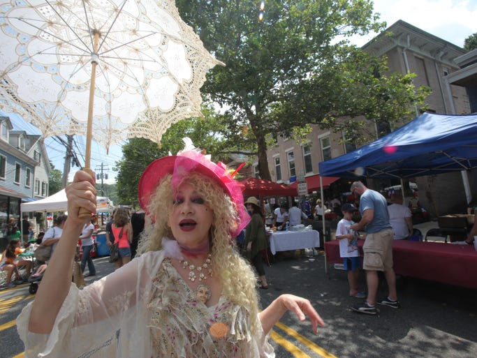 Gabrielle le Duca dresses up in 18th century period costume during Piermont's Bastille Day Festival with live bands and costume contest, as restaurants extend their tables onto the sidewalk on July 12, 2014.
