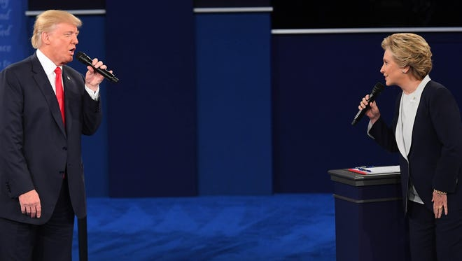 Democratic presidential candidate Hillary Clinton and Republican presidential candidate Donald Trump during the second presidential debate, Oct. 9, at Washington University in St Louis.