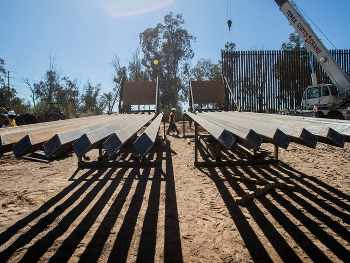 A metal barrier separating Mexico and the U.S. is being
