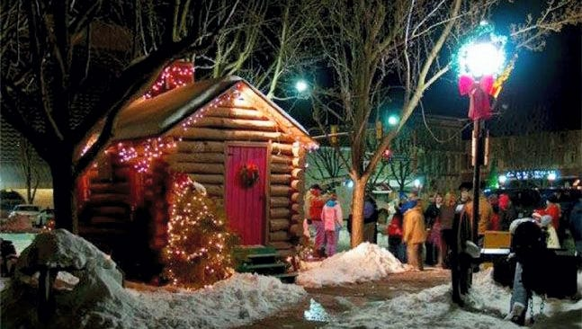 A group waits outside the Santa Cabin in downtown Hanover during the 2013 Christmas Festivities held annually on Black Friday