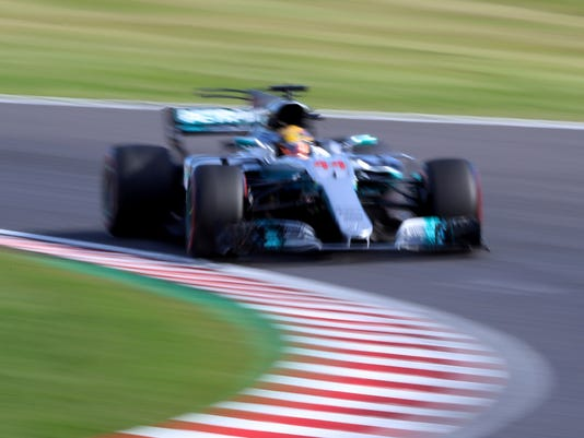 Mercedes driver Lewis Hamilton of Britain steers his car during the Japanese Formula One Grand Prix at Suzuka, Japan, Sunday, Oct. 8, 2017. (AP Photo/Eugene Hoshiko)