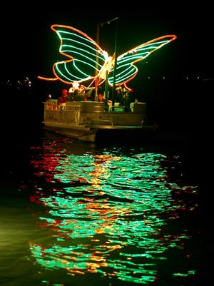 This beautiful butterfly appeared alive as it moved its wings and seemed to float just a few feet over the water in the Isles of Capri's 11th Annual Christmas Boat Parade mounted on a pontoon boat captained by Matt Crowder. After the parade, it was relocated on land in front of the Zagat Award winning Blue Heron Restaurant on the Isles of Capri. Photo submitted by Jim Hughes