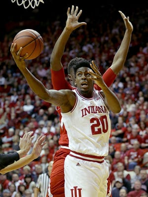 Indiana Hoosiers forward De'Ron Davis (20) drove around Nebraska Cornhuskers center Jordy Tshimanga (32) in the first half of their game Dec. 28, 2016. Over the summer, he worked to get in better shape.