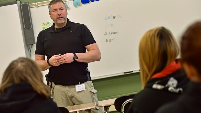 Joe Maclaughlin, of Franklin County Probation, speaks to a group of James Buchanan High School students about his career. Freshman students got the opportunity to listen to career advice during rotating sessions at JBHS Thursday, Feb. 18, 2016.