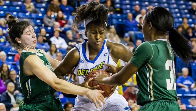 Delaware's Nicole Enabosi (center) fights for the ball with William & Mary's Marlena Tremba (left) and Victoria Reynolds (right) in the second half of the University of Delaware's 60-49 loss to College of William & Mary at the Bob Carpenter Center in Newark on Monday afternoon.