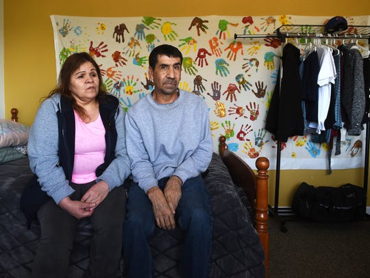 David Chavez-Macias and his wife Leticia Guillen sit