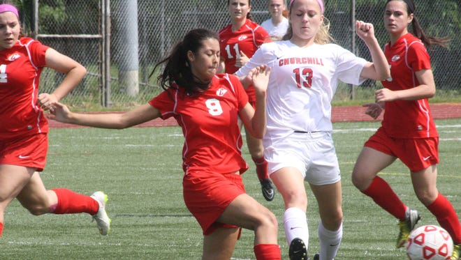 Canton's Nicole Doucet separates the ball from the foot of Churchill's Lauren Wynns.