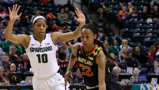Maryland guard Shatori Walker-Kimbrough (32) drives around Michigan State guard Branndais Agee (10) during the first half of MSU's 100-89 loss in the Big Ten women's tournament semifinal Saturday in Indianapolis.