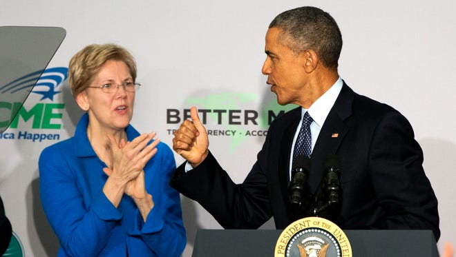 Sen. Elizabeth Warren, D-Mass. applauds as President Barack Obama makes the thumbs up sign as he arrives to speak at AARP in Washington, Monday, Feb. 23, 2015. President Barack Obama says too few Americans approaching retirement have saved enough to have peace of mind during their later years.