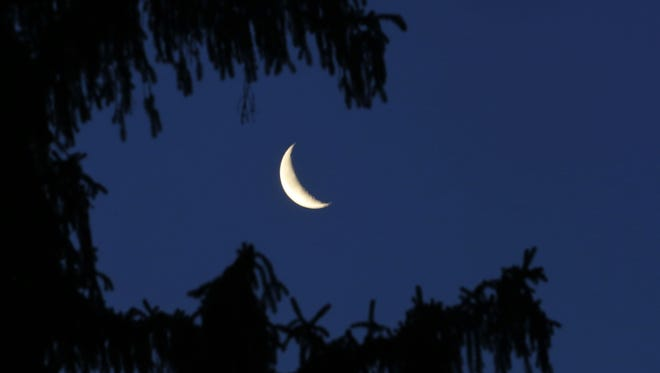 The moon in the clear Wednesday morning sky.