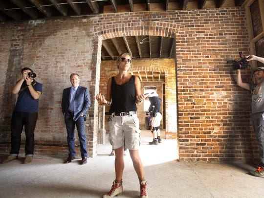 """Nicole Curtis, host of the show """"Rehab Addict,"""" gives the media a tour of the Ransom-Gillis mansion in Detroit's Brush Park district this month."""