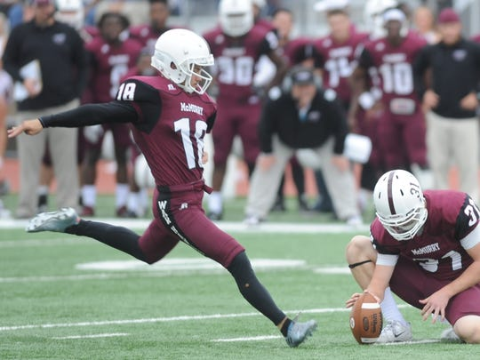 McMurry's Tanner Wright, left, prepares to kick a PAT as Kyle Peggram holds during the War Hawks game against Louisiana College. McMurry won the game 34-28 on Nov. 5, 2016 at Wilford Moore Stadium.