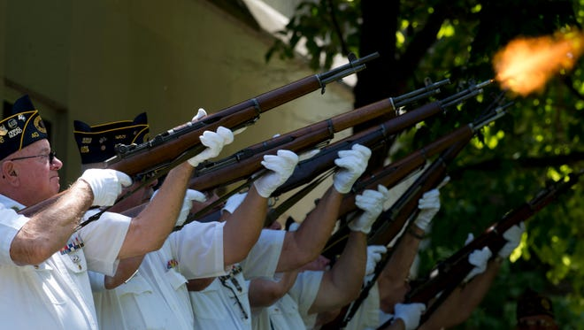 The Henderson American Legion Post 40 Honor Guard performs a 21-gun salute during the Memorial Day service at Central Park Monday morning.