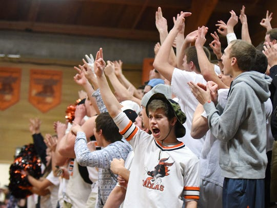 Fans cheer on Dallas as the Dragons defeat Central in a Mid-Willamette Conference game on Wednesday, Feb. 11, 2015, in Dallas. Dallas defeats Central in a Mid-Willamette Conference game on Wednesday, Feb. 11, 2015, in Dallas.