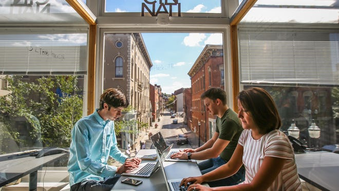 Casamatic CEO Alex Bowman, left, Chief Technology Officer Chris Ridenour and Partner Advocate Sarah Felix work at The Brandery in Over-the-Rhine. Casamatic is part of The Brandery's 2015 class, but their office space is in the 84.51° headquarters.