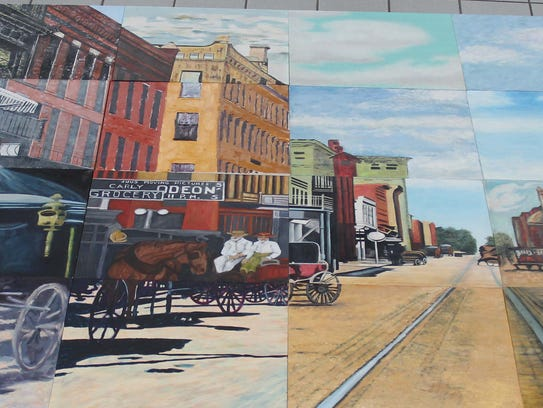 This mural of downtown Muncie of yesteryear, created