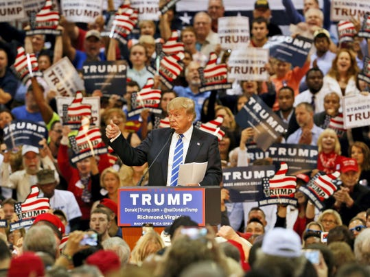 Republican presidential hopeful Donald Trump gestures during a speech to  supporters at a rally in Richmond, Va., Wednesday, Oct. 14, 2015.  (AP Photo/Steve Helber)