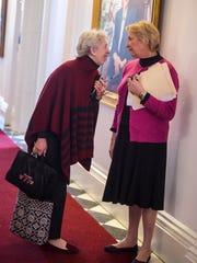 Sen. Alison Clarkson, D-Windsor, left, visits with
