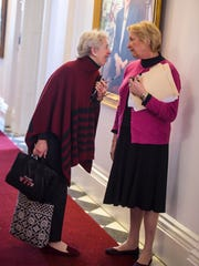 Sen. Alison Clarkson, D-Windsor, left, visits with