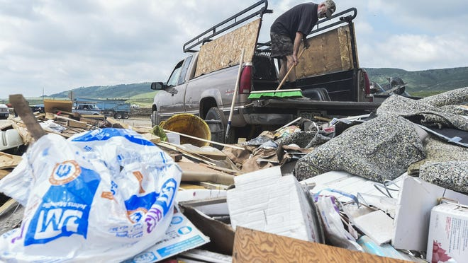 Skip Winne empties trash out of his truck at the Larimer County Landfill June 18 in Fort Collins. The amount of garbage dumped at the landfill more than doubled between 2010 and 2014.