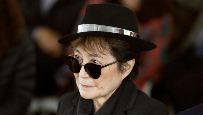In a Friday, June 12, 2015 file photo, artist Yoko Ono appears during a ceremony announcing the future installation of Ono's first permanent public art installation in the U.S., in Chicago. Ono was  hospitalized Friday, Feb. 26, 2016 for flu-like symptoms, but her representative said the singer was on the mend and should be released soon.
