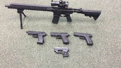 These weapons were recovered from three people charged with breaking into a business in Broussard.
